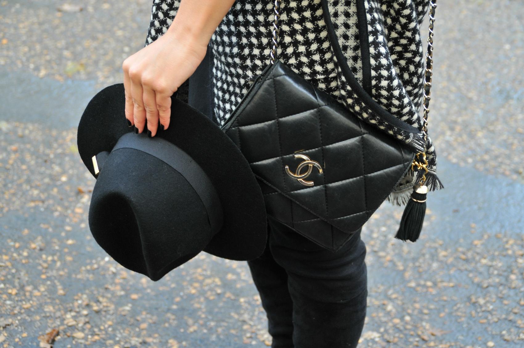vintage chanel handbag over knee boots vintage black fedora hat