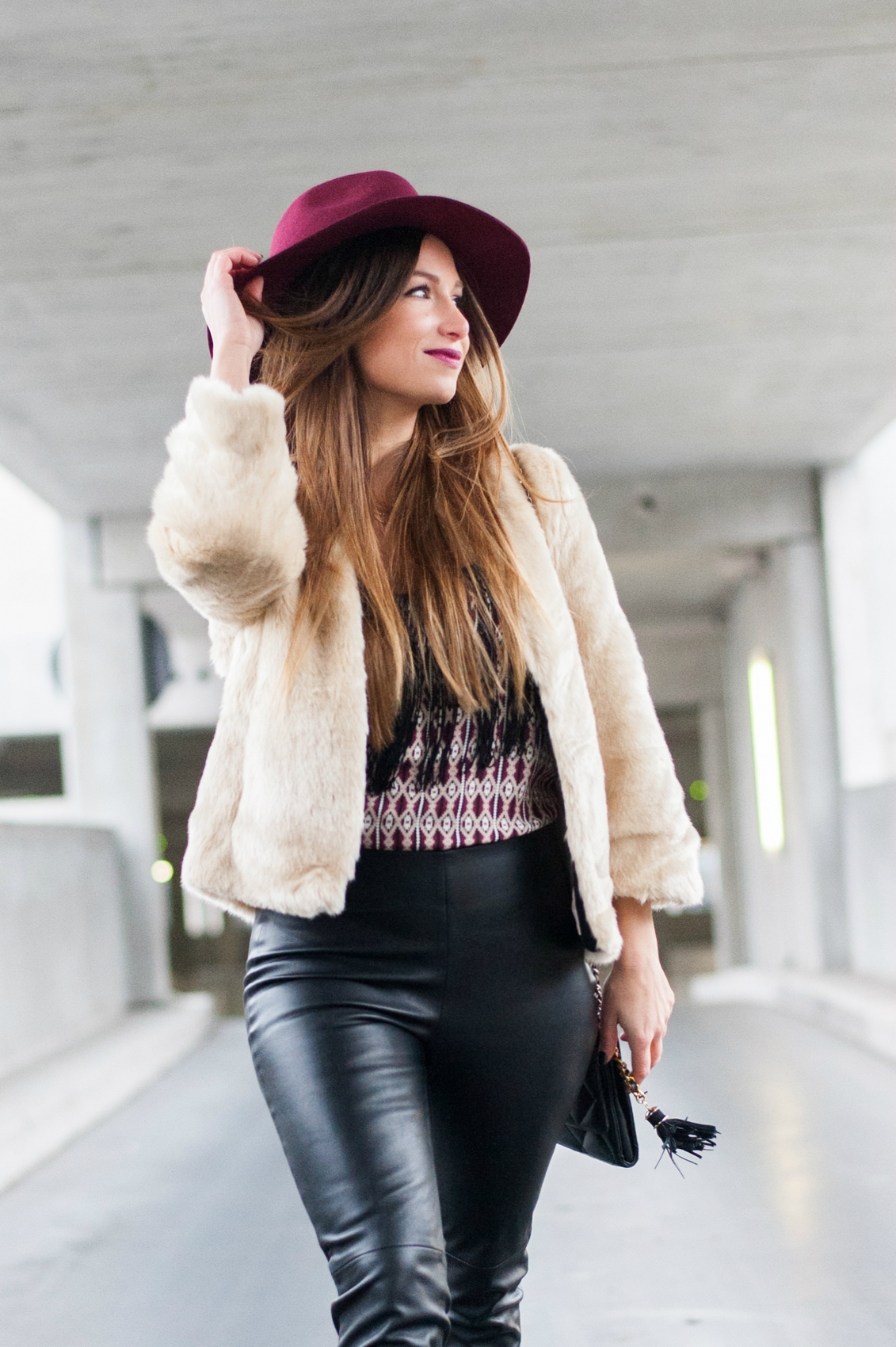 boho rock look fashion blog burgundy touch faux fur cream coat biker leather pant fringed ethnic top