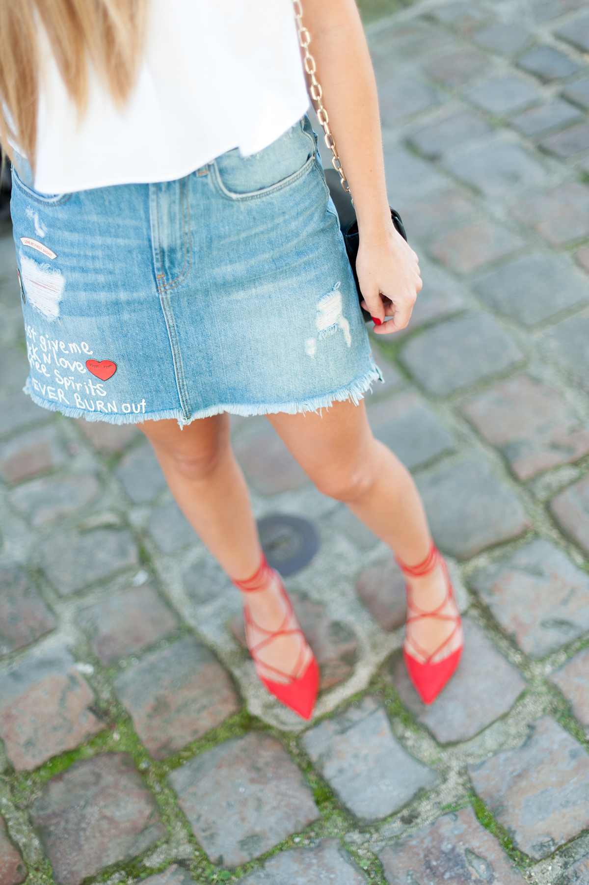 denim skirt and red shoes